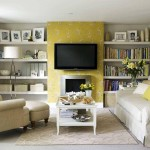 classy-living-room-design-with-beautiful-floral-wallpaper-decor-and-v-on-the-wall-above-firplace-between-shelves-on-the-wall-along-with-white-table-on-brown-rug[1]